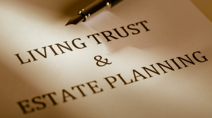 """Fountain Pen Lying On The """"Living Trust And Estate Planning"""" – Close Up"""